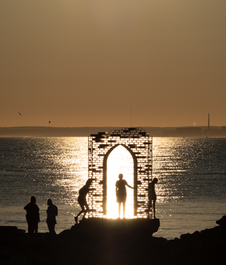 Summer magic: 'If Portals Could Raise a Ruin' by Carla Edwards in the setting sun