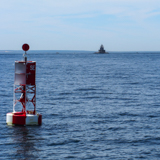 Silver Eel Cove buoy with Race Rock Light in the background